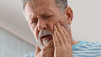 man with severe toothache