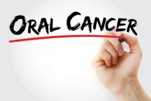 """hand underlining """"oral cancer"""" in marker"""