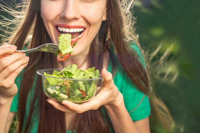 woman eating salad for National Nutrition Month in Charlottesville